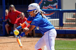Florida Gators infielder Kelsey Stewart lays down a bunt as the #1 ranked Florida Gators softball team defeats the Illinois State Redbords 11-1 at Katie Seashole Pressly Softball Stadium.  March 6th, 2016. Gator Country photo by David Bowie.
