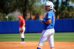 Florida Gators infielder Kelsey Stewart stands on first base with a smile as the #1 ranked Florida Gators softball team defeats the Illinois State Redbords 11-1 at Katie Seashole Pressly Softball Stadium.  March 6th, 2016. Gator Country photo by David Bowie.