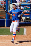 Florida Gators outfielder Kirsti Merritt smiles as she scores to put the Gators up as the #1 ranked Florida Gators softball team defeats the Illinois State Redbords 11-1 at Katie Seashole Pressly Softball Stadium.  March 6th, 2016. Gator Country photo by David Bowie.