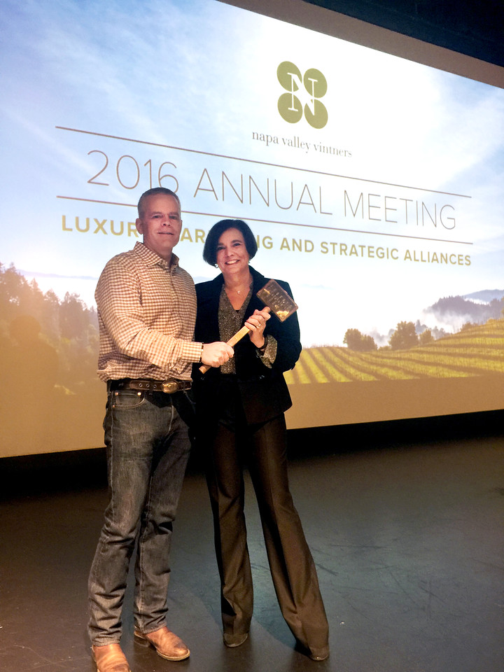 David R. Duncan of Silver Oak and Twomey Cellars passes the ceremonial gavel to incoming NVV Board Chair Emma Swain of St. Supery Estate Vineyards & Winery.