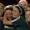 Nashoba players celebrate after winning the Div I Soccer Championship, beating Wachusett in PKs. SENTINEL & ENTERPRISE / Jim Marabello
