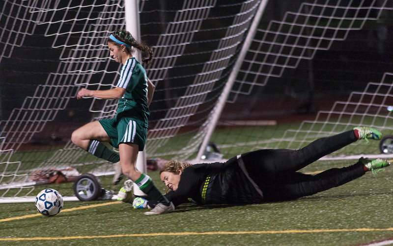 Wachusett Keeper Emma Trudeau pushes the ball wide of Nashoba's Katie Piccioli during the Div I Soccer Championship Game. Nashoba won on PKs. SENTINEL & ENTERPRISE / Jim Marabello