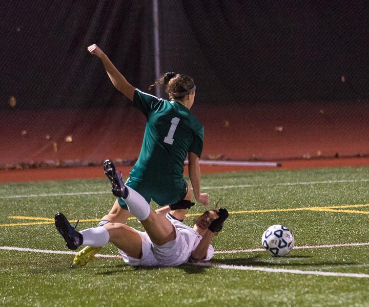 Nashoba's Abby McNulty gets taken down by Wachusett's Annie Vanslette in the Div I Soccer Championship Game. Nashoba won on PKs. SENTINEL & ENTERPRISE / Jim Marabello