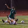 Nashoba's Abby McNulty gets taken down by Wachusett's Annie Vanslette in the Div I Soccer Championship Game. Nashoba won on PKs. SENTINEL & ENTERPRISE / Jim Marabello