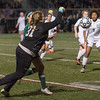 Wachusett Keeper Emma Trudeau punches the ball away from  Katie Piccioli of Nashoba during the Div I Soccer Final. Nashoba prevailed in PKs. SENTINEL & ENTERPRISE / Jim Marabello