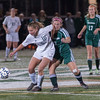 Nashoba's Mariel MacAskill gets an elbow while challenging Wachusett's Nichole Vernon during the Div I Soccer Final. Nashoba prevailed in PKs. SENTINEL & ENTERPRISE / Jim Marabello
