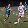 Nashoba's Taylor Rodriguez moves upfield by Wachusett's Samantha Tomaszewski during the Div I Soccer Final. Nashoba prevailed in PKs. SENTINEL & ENTERPRISE / Jim Marabello