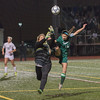 Katie Piccioli of Nashoba goes in hard against Wachusett Keeper Emma Trudeau during the Div I Soccer Final. Nashoba prevailed in PKs. SENTINEL & ENTERPRISE / Jim Marabello