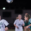 The glitter flies as Nashoba's Sarah Gilooly heads a ball away from Wachusett's Carolyn Heighton during the Div I Soccer Championship Game. Nashoba won on PKs. SENTINEL & ENTERPRISE / Jim Marabello