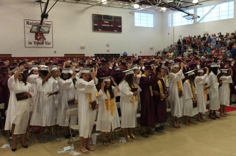 MARK ROBARGE - mrobarge@troyrecord.com Members of the Lansingburgh High School Class of 2016 turn the tassels on their mortarboards after receiving their diplomas at the school's 114th commencement Friday night.