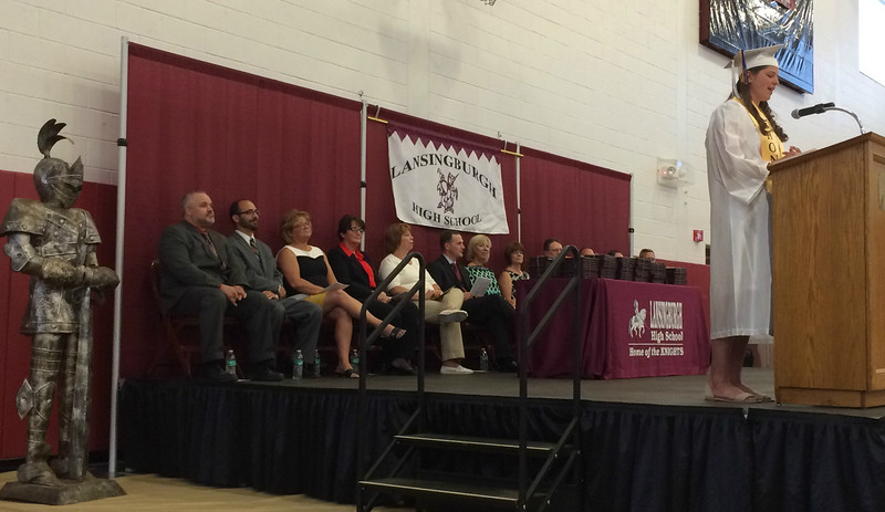 MARK ROBARGE - mrobarge@troyrecord.com Veledictorian Tiffani-Amber Wells addresses her classmates during Lansingburgh High School's 114th commencement Friday night.