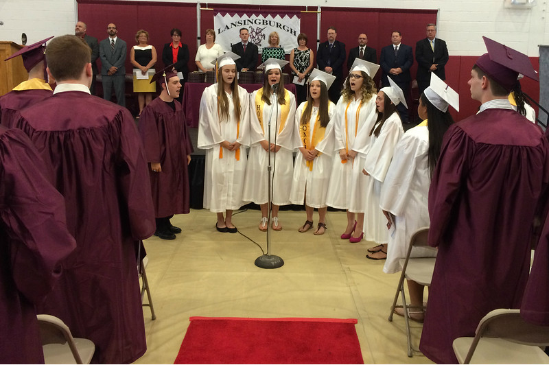 MARK ROBARGE - mrobarge@troyrecord.com Lansingburgh High School seniors Anthony Steen, Mary Evers, Kristen Jordan, Shalyn Palmateer, Lea Simmons and Rose Tefoe sing the National Anthem during the school's 114th commencement Friday night.