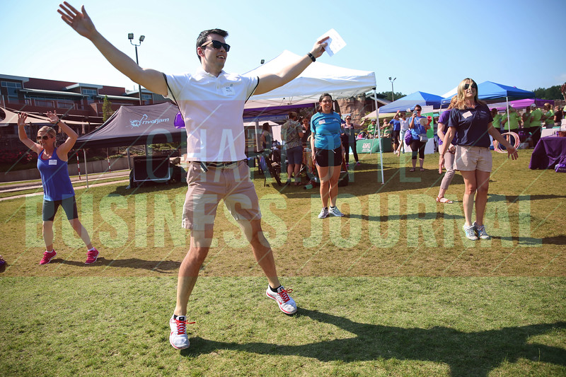 Ben Cox of Accenture does jumping jacks during a contest at the Healthiest Employer's event.