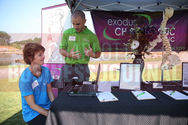 Lundee Covington of Cabarrus County Government gets a quick exam at the Michael Bollin Exodus Chiropractic table.
