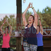 Participants learn some new moves during yoga at the Healthiest Employer's event at the Whitewater Center.