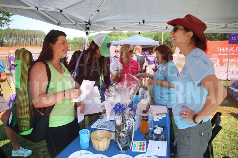 Attendees visit the Care Ring table during the Healthiest Employer's event.