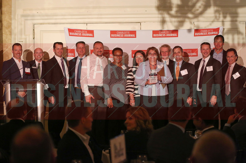 Lash Group HQ Fort Mill project participants accept their Commercial Real Estate Award.