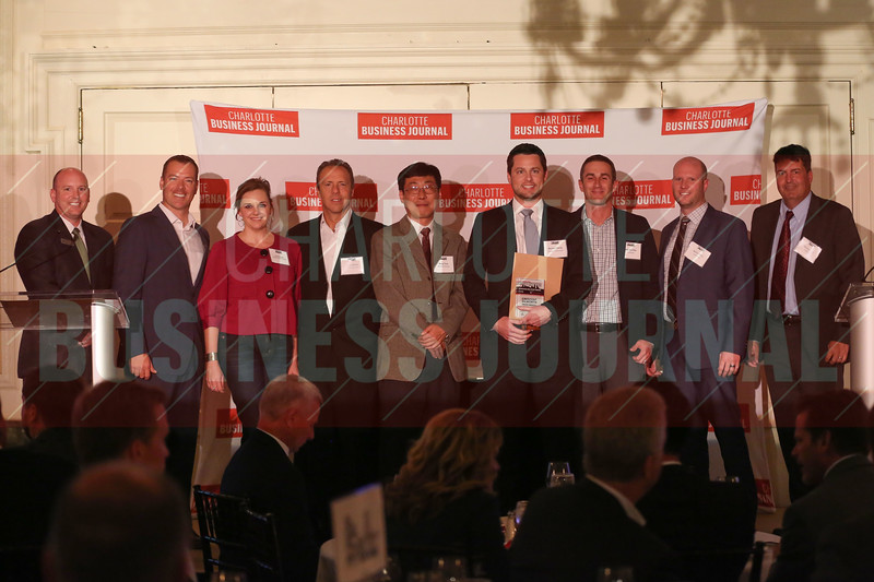 Crescent Dilworth project members accept their Commercial Real Estate Award.
