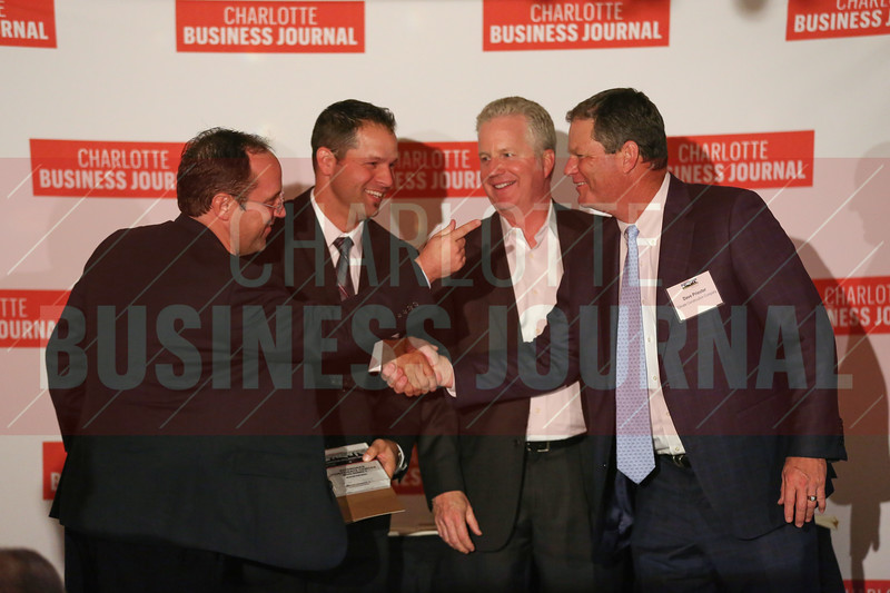 RiverOaks Corporate Center project members accept their Commercial Real Estate Award.