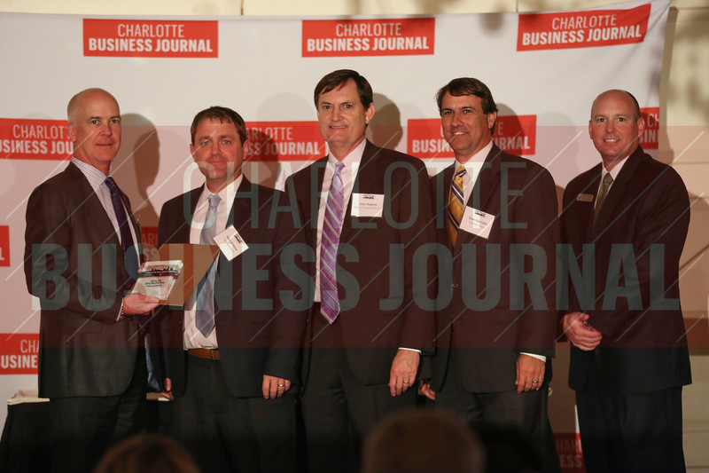 Solis Dilworth project members accept their Commercial Real Estate Award.