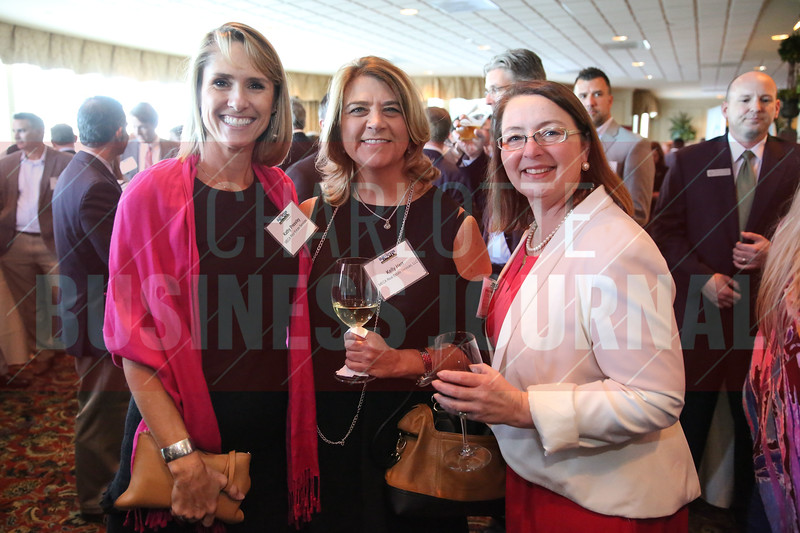 MECA Real Estate Services, LLC team members pose for a photo at the Heavy HItters of Commercial Real Estate Awards.
