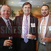 John Hopkins and Brandon Roberson pose for a photo at the Heavy HItters of Commercial Real Estate Awards.