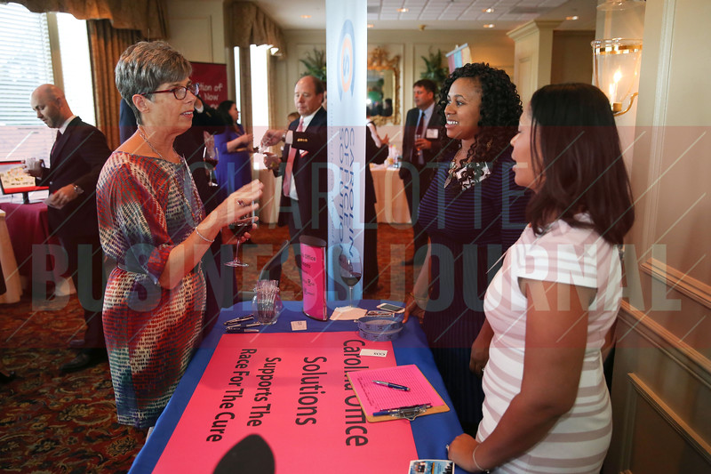 Attendees network at the Carolina Office Solutions table at the Heavy Hitters of Commerical Real Estate Awards.