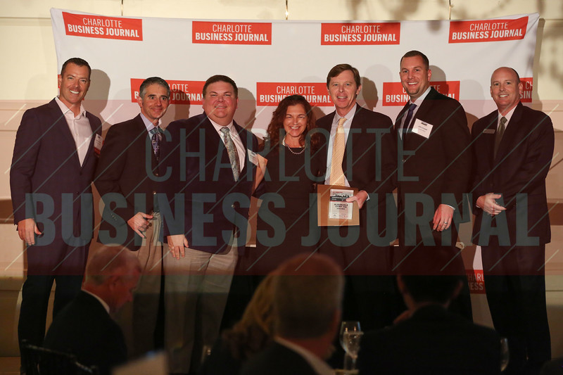 Albemarle Corp. HQ project members accept their Commercial Real Estate Award.