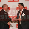 John Third of Movement Mortgage accepts their Commercial Real Estate Award.