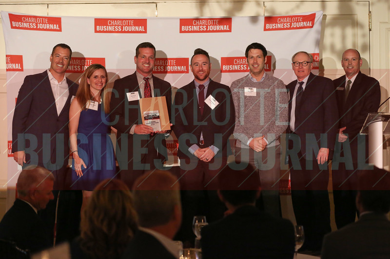 JE Dunn Construction project members accept their Commercial Real Estate Award.