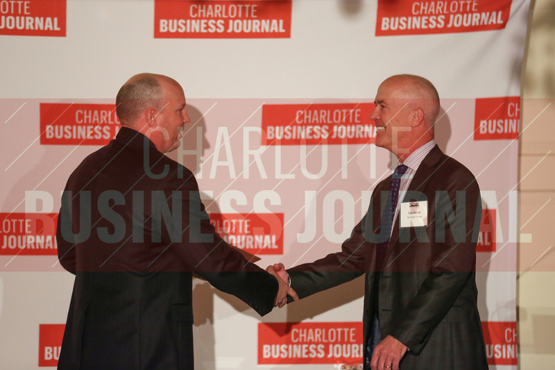 Tom Parker of Terwilliger Pappas accepts the team's Commercial Real Estate Award.