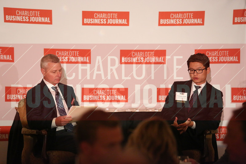 Robert Morris, CBJ Editor, participates in a fireside chat with Christopher Chung, CEO of Economic Developpment Partnership of North Carolina, at the Heavy Hitters of Commercial Real Estate Awards.