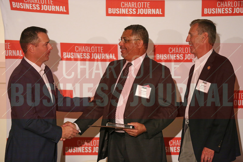 Mecklenburg County Sportsplex Phase II project members accept their Commercial Real Estate Award.