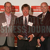 Carowinds Carolina Harbor project members accept their Commercial Real Estate Award.