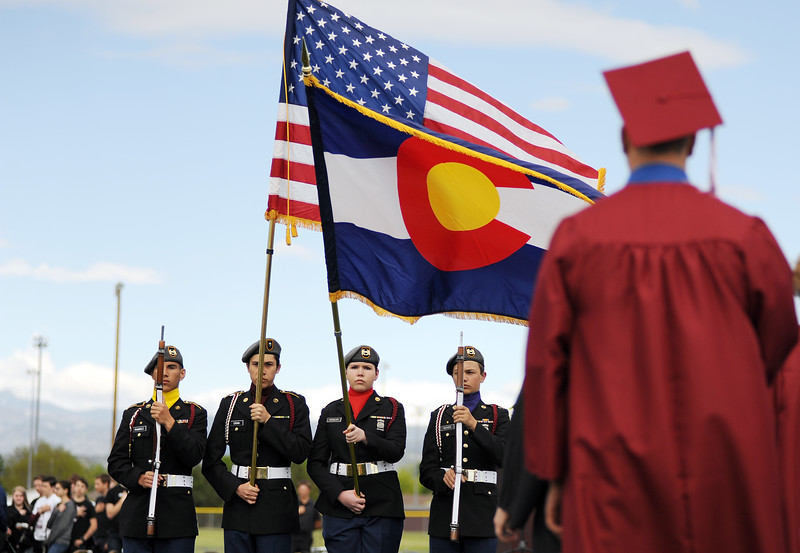 Members of the Berthoud High School JROTC present the colors during the Berthoud High School graduation Saturday at at Max Marr Stadium in Berthoud.