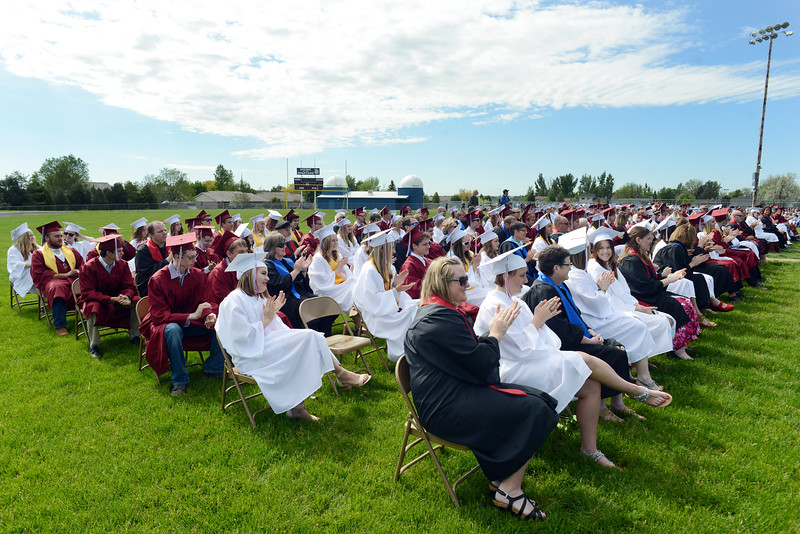 Teachers and graduates react to a speech during the Berthoud High School graduation Saturday at at Max Marr Stadium in Berthoud.