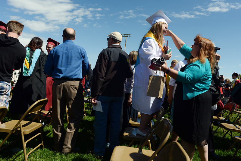 Kim Gosch, right, goes in to hug her daughter, Sierra Gosch, 18, after the Berthoud High School graduation Saturday at at Max Marr Stadium in Berthoud.