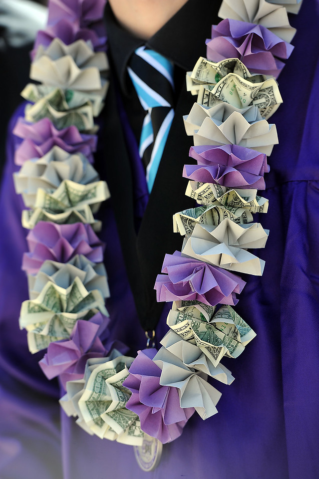Mountain View High School graduate Parker Herd sports a hand-made leis his girlfriend gave him after his graduation ceremony Saturday, May 28, 2016, at The Ranch in Loveland. (Photo by Jenny Sparks/Loveland Reporter-Herald)