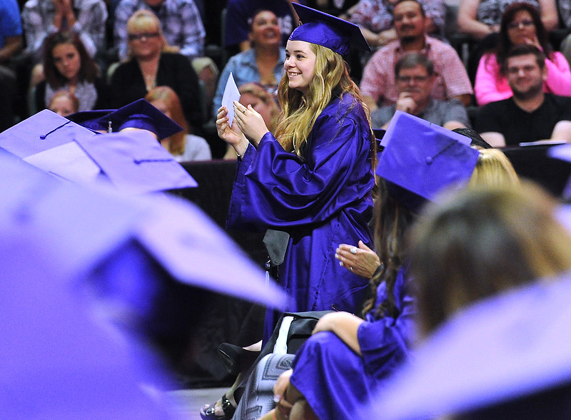 Mountain View High School graduate Jade Owens holds up an envelope she found under her seat with a $100 bill from superintendent Stan Sheer during her graduation ceremony Saturday, May 28, 2016, at The Ranch in Loveland. (Photo by Jenny Sparks/Loveland Reporter-Herald)