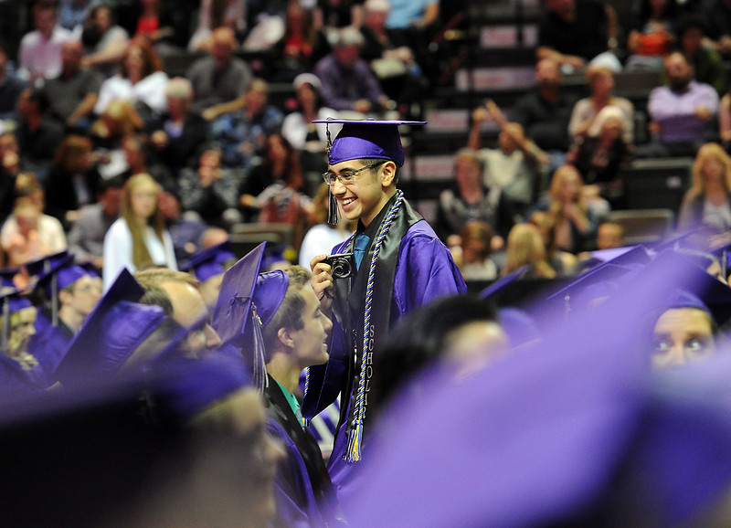 Mountain View High School graduate Michael Palomares takes video of his fellow graduates after getting his deploma Saturday, May 28, 2016, at The Ranch in Loveland. (Photo by Jenny Sparks/Loveland Reporter-Herald)