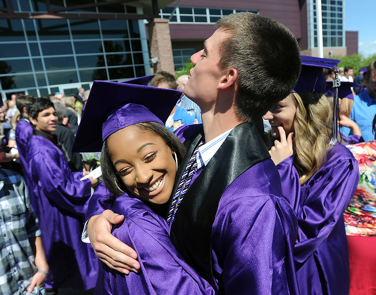 Mountain View High School graduates Brandye Thrash, left, and Dakota Sedillo hug and celebrate after their graduation ceremony Saturday, May 28, 2016, at The Ranch in Loveland. (Photo by Jenny Sparks/Loveland Reporter-Herald)