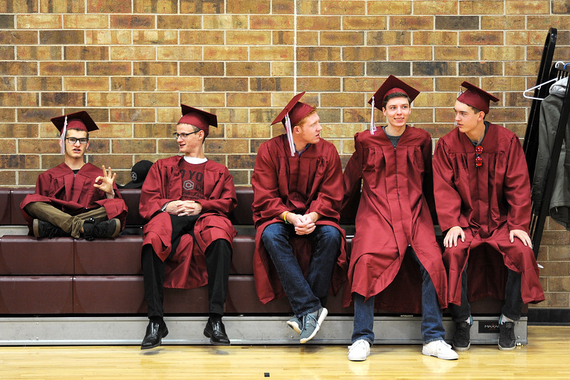 From left, Riley Petitt, 18, Zach Pearson, 18, Steele Castles, 18, Noah Kathol, 18, and Tristin Dorsey, 17, wait for the start of the Berthoud High School graduation Saturday in a school gym.