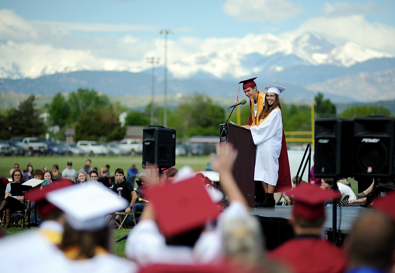 Co-valedictorians, at podium to left, Jonathan Bosnich and Lexia Wyse give shout outs during their speech at the Berthoud High School graduation Saturday at at Max Marr Stadium in Berthoud.