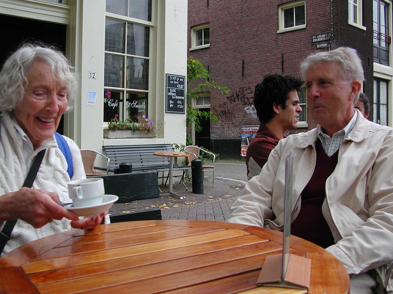 Mom and Bonnie in Amsterdam, having a coffee with our city guide.