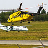 HNZ Helicopters Sikorsky S92 landing on runway 23 with Jazz taxiing on alpha