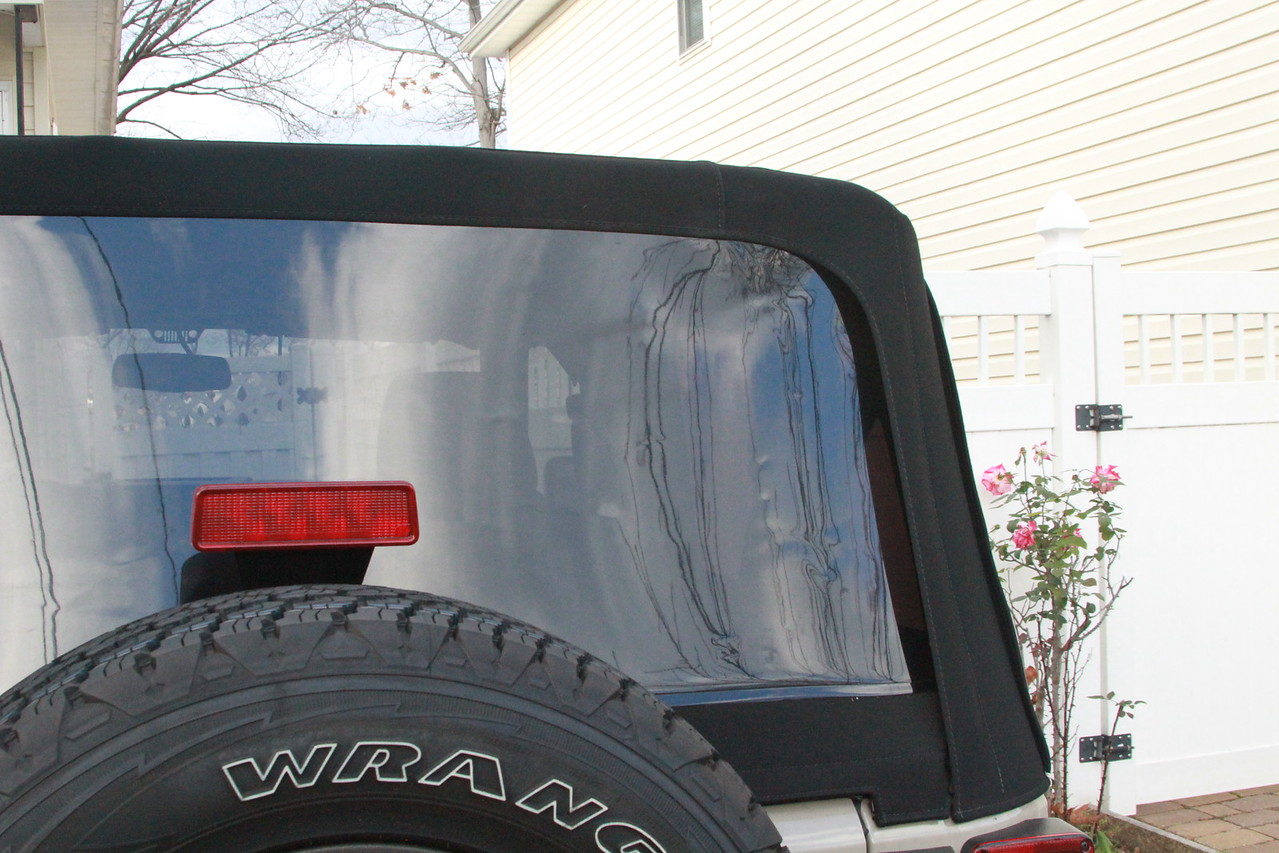 Back window tight as hell, zipper won't budge