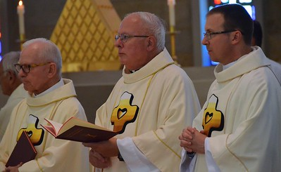 Jubilarians Fr. John, Fr. Joe and Fr. Greg at the altar