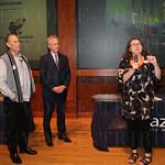 Artist Julius Friedman and Mayor Greg Fischer listened as the President and CEO Penelope Peavler spoke.