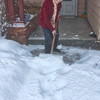Some serious snow in December:  Ruth Bay getting started on her front sidewalk -- help is on the way!