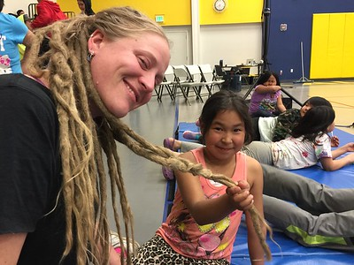 Stage Manager Kadey getting up close and personal with the kiddies. Her hair is always a topic of conversation in villages!